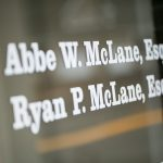 "Window decals saying ""Abbe W. McLane, Esq. & Ryan P. McLane, Esq."""